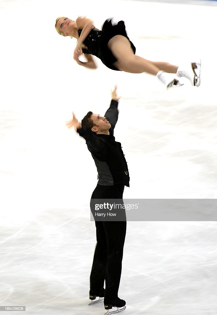 Kirsten Moore-Towers and Dylan Moscovitch of Canada compete to a silver medal during the pairs free at Skate America 2013 at the Joe Louis Arena on October 20, 2013 in Detroit, Michigan.
