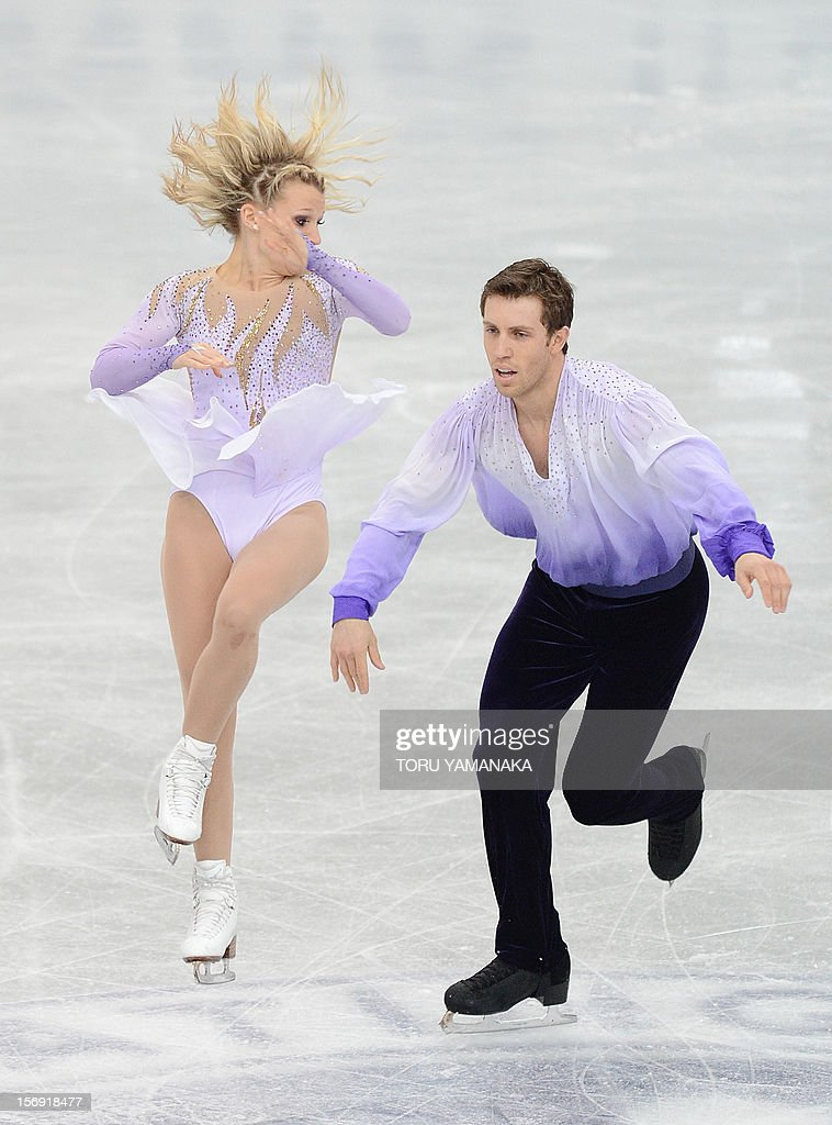 Kirsten Moore-Towers (L) and Dylan Moscovitch (R) of Canada perform during pairs free skating event at the NHK Trophy, the last leg of the six-stage ISU figure skating Grand Prix series, in Rifu, northern Japan, on November 25, 2012. The Canadian pair won the silver medal in the competition. AFP PHOTO/Toru YAMANAKA