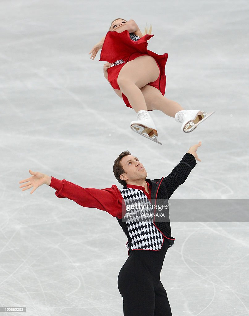 Kirsten Moore-Towers (top) and Dylan Moscovitch (bottom) of Canada perform during the pairs' short program in the NHK Trophy, the last leg of the six-stage ISU figure skating Grand Prix series, in Rifu, northern Japan, on November 24, 2012. AFP PHOTO / Toru YAMANAKA