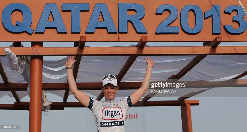 Kirsten Wild of Netherlands celebrates on the podium after winning the final stage of the Tour of Qatar women's cycling race in the capital Doha, on February 1, 2013. The route of the final and fourth stage covered 86.5 kilometres from the Sealine Beach Resort to the Doha Corniche.