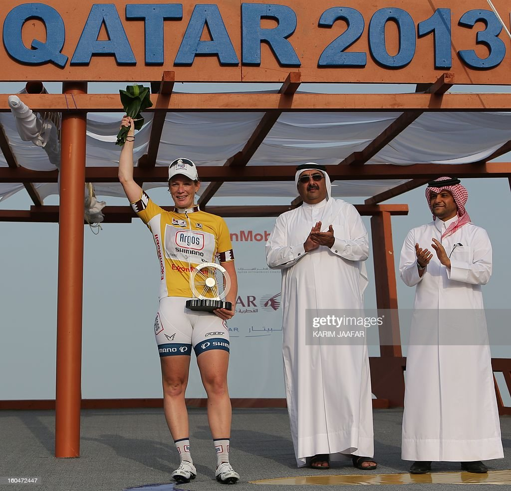 Kirsten Wild (C) of Netherlands, wearing the leader's gold jersey, poses on the podium with president of the Qatar Cycling Federation, Sheikh Khaled bin Ali al-Thani (C) and Secretary General of Qatar's Olympic Committee Sheikh Saud bin Abdul Rahman al-Thani, after winning the final stage of the Tour of Qatar women's cycling race in the capital Doha, on February 1, 2013. The route of the final and fourth stage covered 86.5 kilometres from the Sealine Beach Resort to the Doha Corniche. AFP PHOTO / AL-WATAN DOHA / KARIM JAAFAR == QATAR OUT ==
