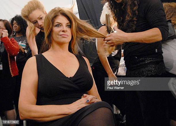 Kirstie Alley has her hair done before attending the Zang Toi show during Spring 2013 MercedesBenz Fashion Week at The Stage Lincoln Center on...
