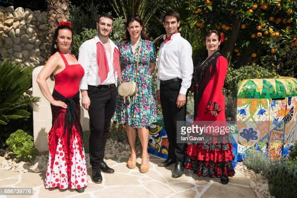 Kirstie Allsopp poses with traditional Spanish flamenco dancers at the RHS Chelsea Flower Show on May 22 2017 in London United Kingdom With Their...