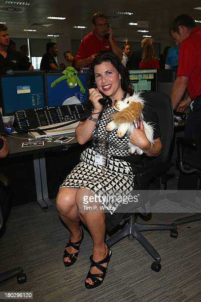 Kirstie Allsopp speaks on the phone on the trading floor during the BGC Charity Day 2013 at BGC Partners on September 11 2013 in London England