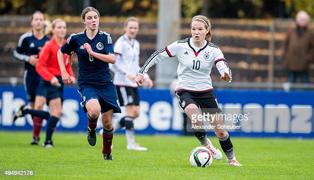 Kirstie McIntosh of Scotland challenges Laura Haas of Germany during the international friendly match between U15 Girl's Germany and U15 Girl's...