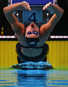 Kirsty Coventry of Zimbabwe competes in the Women's 50m Backstroke Semifinal during the ninth FINA World Swimming Championships at the MEN Arena on...