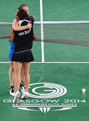 Kirsty Gilmour of Scotland and Michelle Chan of New Zealand embrace over the net after their women's singles badminton quarterfinal match at Emirates...