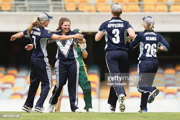 Kirsty Lamb of the Spirit celebrates with team mates the wicket of Amy Satterthwaite of the Roar during the round one WNCL match between Victoria and...