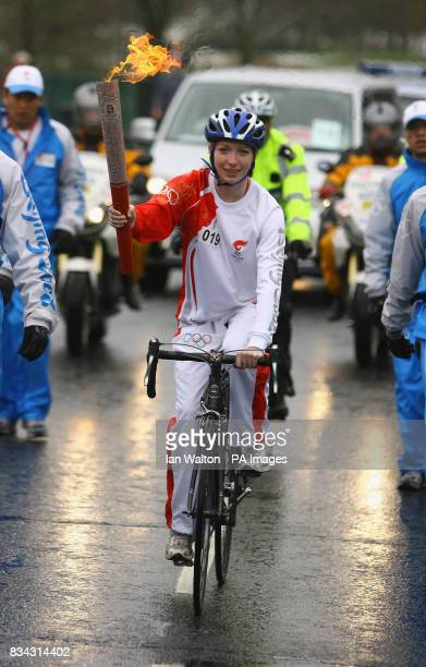 Kirsty McWilliam carries the Olmypic torch during its relay journey across London on its way to the lighting of the Olympic cauldron at the O2 Arena...