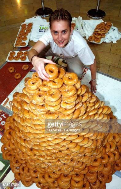 Kirsty Scott manageress of the Krispy Kreme doughnut shop in Birmingham's Bull Ring shopping centre builds the world's largest freestanding doughnut...