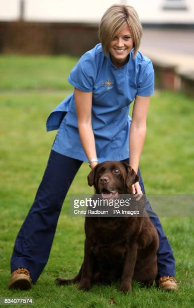 Kirsty Thompson from Eastgate vetenary group in Bury St Edmunds with Rusty a chocolatecoloured Labrador who has lost five stone in less than two years