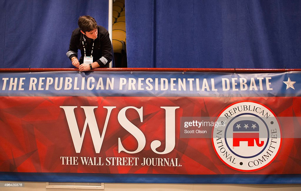 Kirt Gallatin helps to prepare for the Republican presidential debate sponsored by Fox Business News and the Wall Street Journal on November 9 2015...