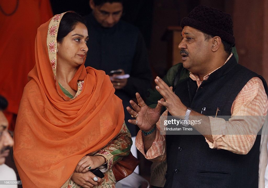 Kirti Azad with Shiromani Akali Dal MP Harsimrat Kaur Badal at Parliament House during the ongoing winter session on December 11, 2012 in New Delhi, India. India's parliament was disrupted for the second successive day as opposition lawmakers over Wal-Mart's discloser in U.S. senate that it has spent $25 million for lobbying activities in India.