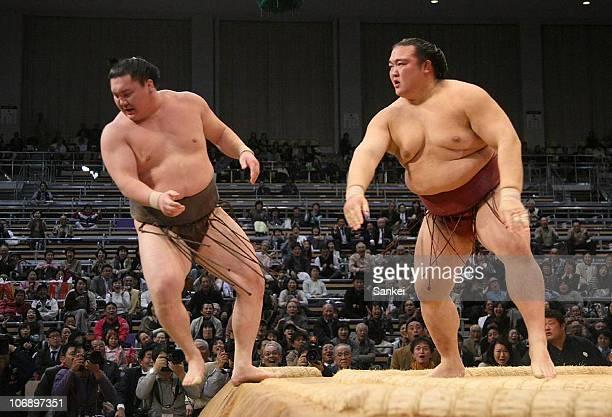Kisenosato forces out Mongolian Yokozuna sumo grand champion Hakuho from the ring during the day two of the Grand Sumo Kyushu Tournament at Fukuoka...