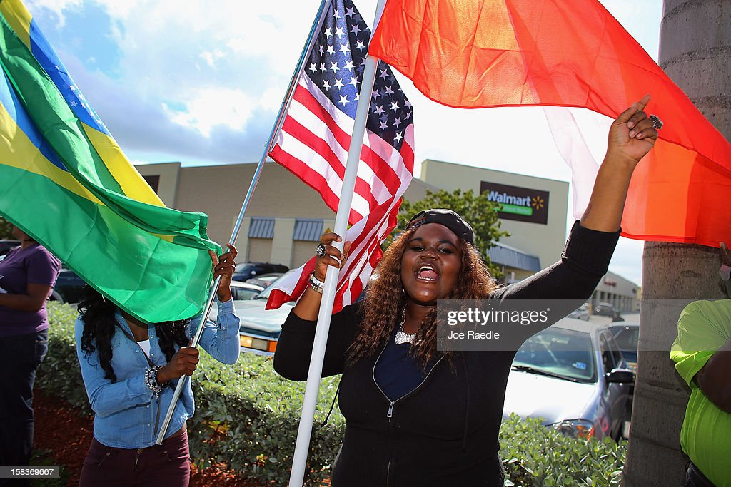 Kishana Bennett and others participate in a 'Global Day' of action against Walmart on December 14, 2012 in Hialeah, Florida. The protesters in partnership with the global union federation UNI, the union-affiliated group Making Change at Walmart joined others around the world to among other things call for an end to alleged retaliation against US Walmart worker activists.