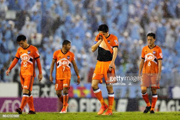 Kisho Yano and Albirex Niigata players show dejection after the 22 draw in the JLeague J1 match between Jubilo Iwata and Albirex Niigata at Yamaha...