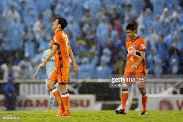 Kisho Yano and Song Ju Hun of Albirex Niigata show dejection after the 22 draw in the JLeague J1 match between Jubilo Iwata and Albirex Niigata at...
