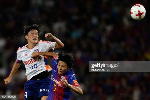 Kisho Yano of Albirex Niigata and Yuichi Maruyama of FC Tokyo compete for the ball during the JLeague J1 match between FC Tokyo and Albirex Niigata...