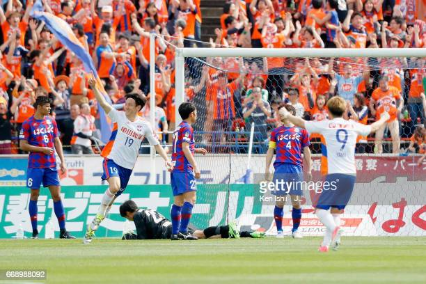 Kisho Yano of Albirex Niigata celebrates scoring his side's second goal with his team mates during the JLeague J1 match between Ventforet Kofu and...