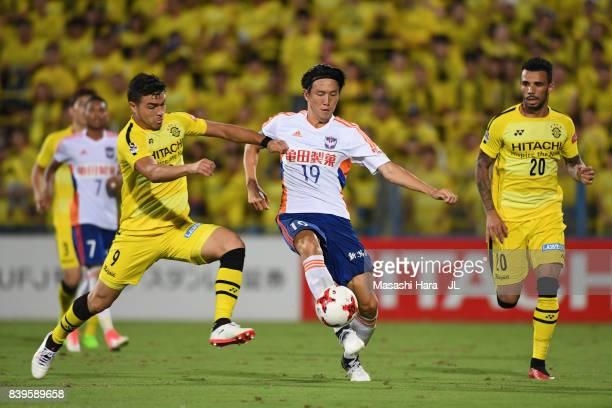 Kisho Yano of Albirex Niigata controls the ball under pressure of Cristiano of Kashiwa Reysol during the JLeague J1 match between Kashiwa Reysol and...