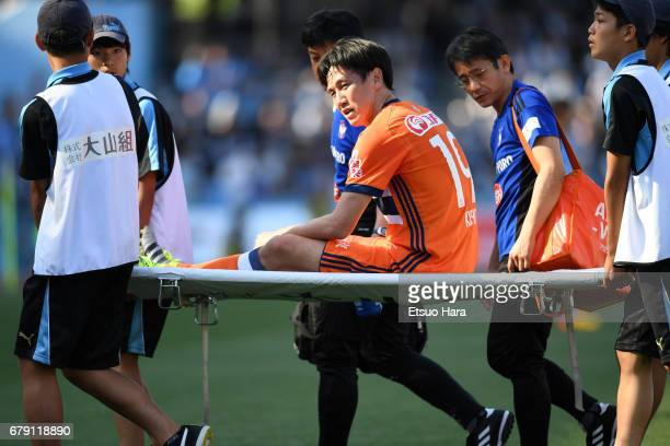 Kisho Yano of Albirex Niigata is stretched off the pitch after being injured during the JLeague J1 match between Kawasaki Frontale and Albirex...