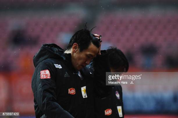 Kisho Yano of Albirex Niigata shows dejection after his team's relegation to the J2 despite their 10 victory in the JLeague J1 match between Albirex...