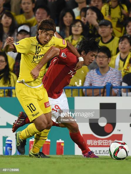 Kisho Yano of Nagoya Grampus and Yuki Otsu of Kashiwa Reysol compete for the ball during the JLeague match between Kashiwa Reysol and Nagoya Grampus...