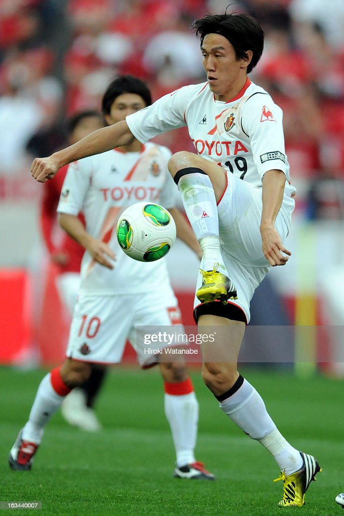 <a gi-track='captionPersonalityLinkClicked' href=/galleries/search?phrase=Kisho+Yano&family=editorial&specificpeople=4430794 ng-click='$event.stopPropagation()'>Kisho Yano</a> of Nagoya Grampus in action during the J.League match between Urawa Red Diamonds and Nagoya Grampus at Saitama Stadium on March 9, 2013 in Saitama, Japan.