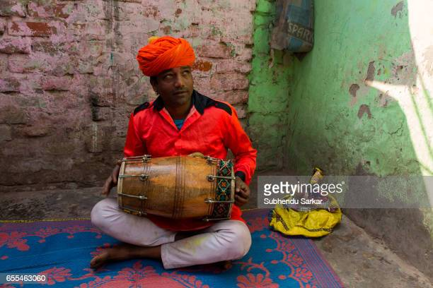 Kishor Bhaat plays dhol in the Kathputhli Colony in New Delhi The colony is a slum where for the last fifty years more than 3000 families of...