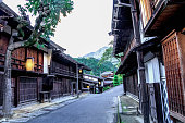 Kiso valley is the old  town or Japanese traditional wooden buildings for the travelers walking at historic old street  in Narai-juku , Nagano Prefecture, JAPAN.
