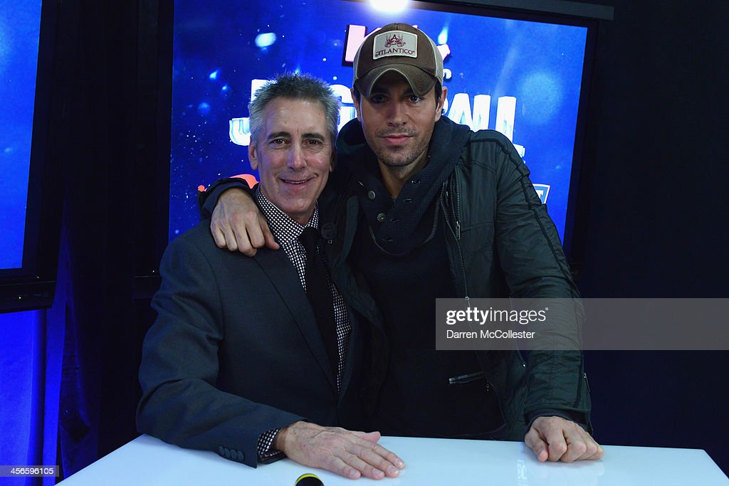 Kiss 108's Billy Costa and <a gi-track='captionPersonalityLinkClicked' href=/galleries/search?phrase=Enrique+Iglesias+-+Singer&family=editorial&specificpeople=202672 ng-click='$event.stopPropagation()'>Enrique Iglesias</a> talk backstage at KISS 108's Jingle Ball 2013 at TD Garden on December 14, 2013 in Boston, MA.