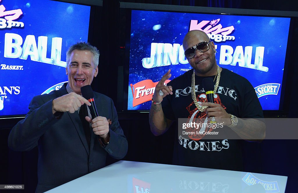 Kiss 108's Billy Costa and <a gi-track='captionPersonalityLinkClicked' href=/galleries/search?phrase=Flo+Rida&family=editorial&specificpeople=4456012 ng-click='$event.stopPropagation()'>Flo Rida</a> talk backstage at KISS 108's Jingle Ball 2013 at TD Garden on December 14, 2013 in Boston, MA.