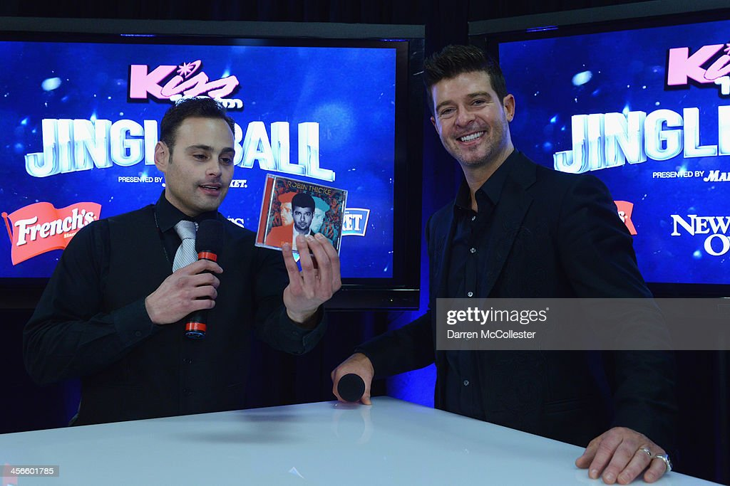 Kiss 108's Romeo interviews <a gi-track='captionPersonalityLinkClicked' href=/galleries/search?phrase=Robin+Thicke&family=editorial&specificpeople=724390 ng-click='$event.stopPropagation()'>Robin Thicke</a> backstage at KISS 108's Jingle Ball 2013 at TD Garden on December 14, 2013 in Boston, MA.