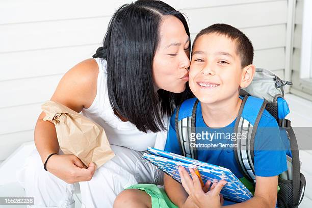 Kiss from mother before school