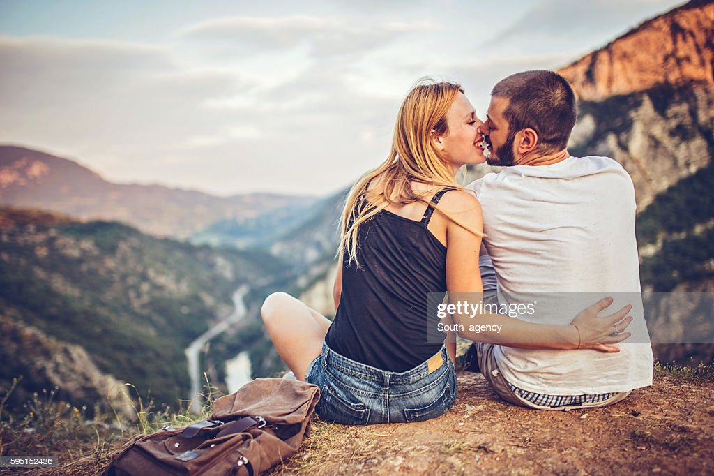 Kiss her on the top of the mountain