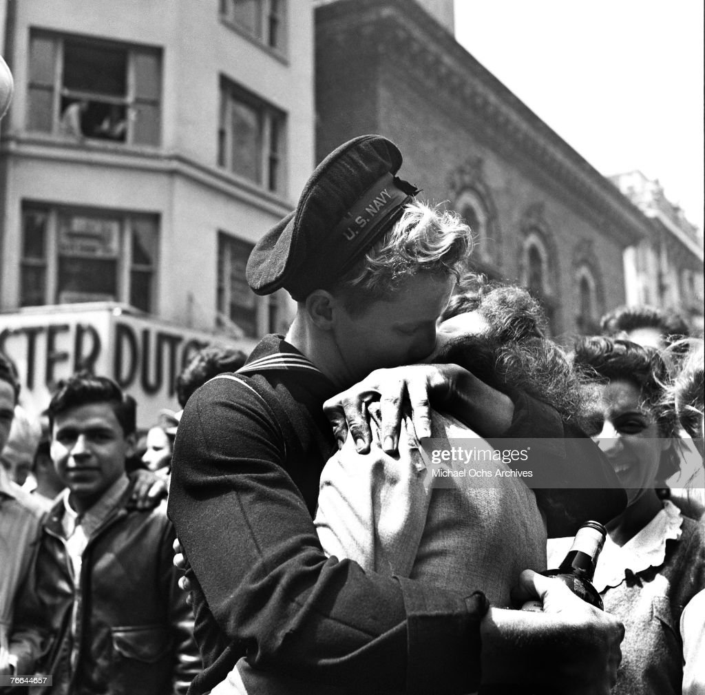 A kiss in Times Square displays the mood of the world on V-E Day (or 'Victory in Europe' Day), signalling the end of hostilities in the European theater in World War II, on May 8, 1945, in New York, New York.