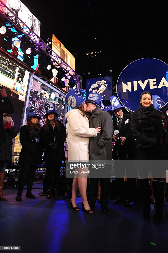 Kiss of the Year contest winners Allie and Seth Butler share their true love story on the NIVEA Kiss Stage in Times Square on New Year's Eve 2013 in New York City.