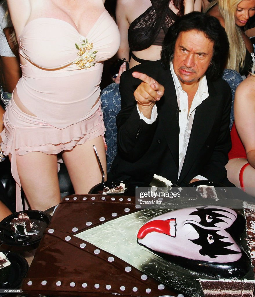 Kiss singer/bassist Gene Simmons, sitting next to adult film actress Taylor Wane, gestures during his birthday party at the Ghostbar at the Palms Casino Resort August 25, 2005 in Las Vegas, Nevada.