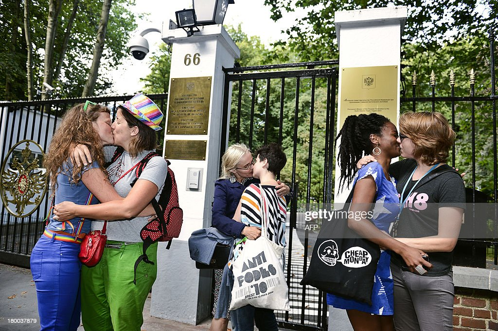 A 'Kiss-In' action takes place at the Russian embassy in Brussels to protest against the Russian governmental policies for lesbian, gay, bisexual and transgender oriented people, on September 8, 2013.