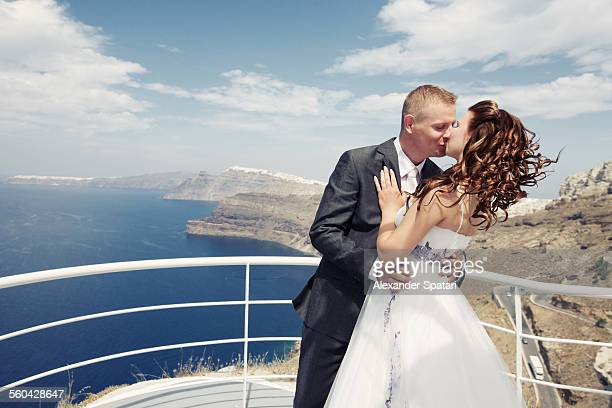 Kissing bride and groom in Santorini, Greece
