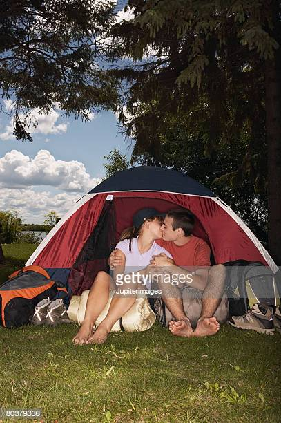 Kissing couple in tent