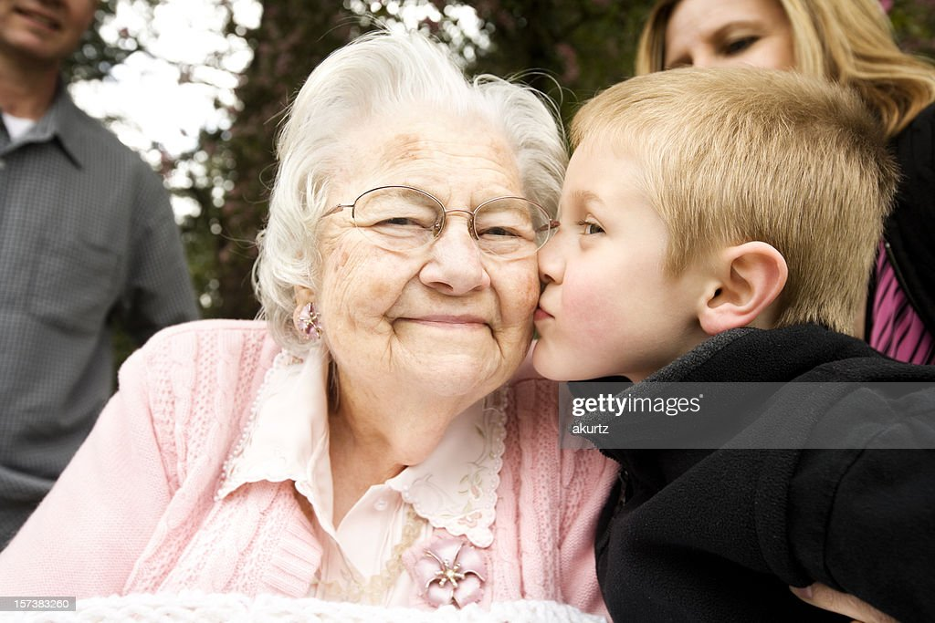 Kissing Great Grandma 80 years grandson retirement senior