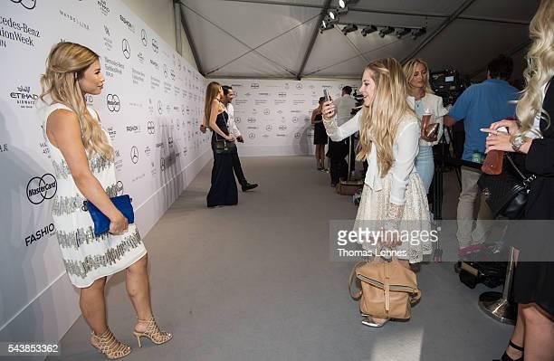 Kisu and Carmen Mercedes are seen during the MercedesBenz Fashion Week Berlin Spring/Summer 2017 at Erika Hess Eisstadion on June 29 2016 in Berlin...