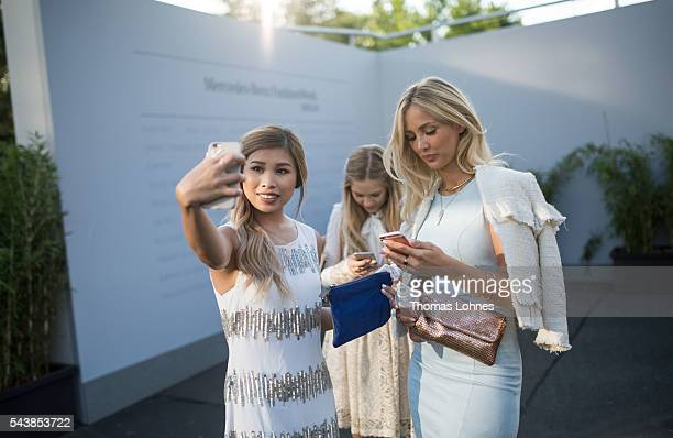 Kisu and Carmen Mercedes are seen during the MercedesBenz Fashion Week Berlin Spring/Summer 2017 at Erika Hess Eisstadion on June 29 2016 in Berlin...