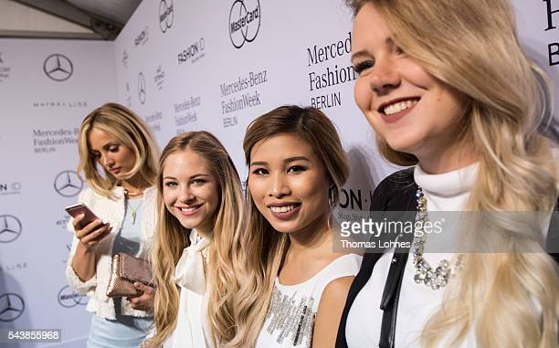 Kisu Carmen Mercedes Diana zu Loewen and Kristina Derichs are seen with Quickacap bottles during the MercedesBenz Fashion Week Berlin Spring/Summer...