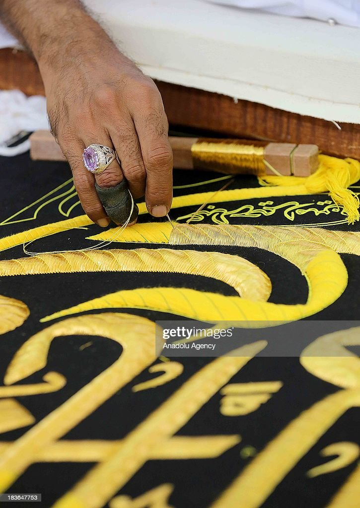 Kiswah, the cloth that covers the Kaaba, is being prepared on October 8, 2013 in Mecca, Saudi Arabia for the Hajj period of 2014. Kiswah, draping Kaaba one of the most sacred sites in Islam, is being changed the day pilgrims leave for the plains of Mount Arafat during the Hajj which is the muslim pilgrimage performed by circumambulation of the Kaaba. The Holy Kabah Kiswah factory completes the new Kiswah to be draped on October 14, 2013 in 8 months and has started the one for 2014 already. The cover of 2013 weigh 2 tones, 120 kg of free gold and 746 kg of silken fabrics used for making and did cost 6 million dollars.