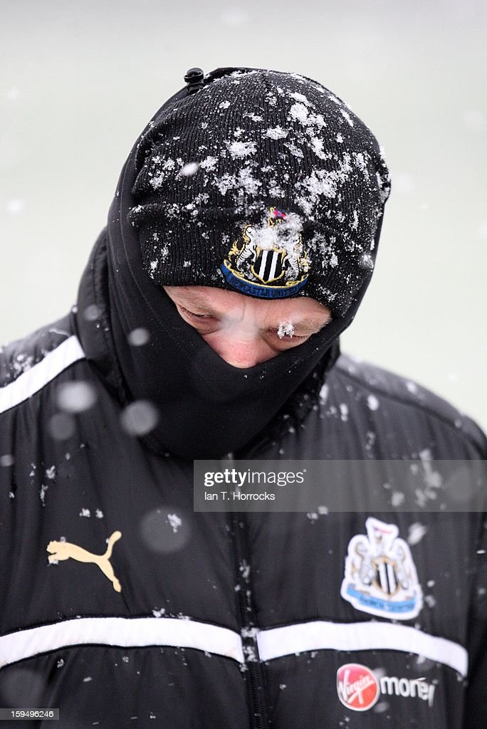 Kit assistant Neil Stoker covers himself from the cold during a Newcastle United training session at the Little Benton Training Ground on January 14, 2013 in Newcastle upon Tyne, England.