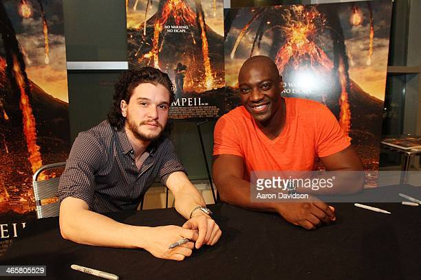 Kit Harington and Adewale AkinnuoyeAgbaje greet fans to promote the film 'Pompeii' at Regal South Beach on January 29 2014 in Miami Florida