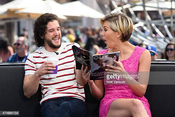 Kit Harington and Charissa Thompson visit 'Extra' at Universal Studios Hollywood on May 28 2015 in Universal City California