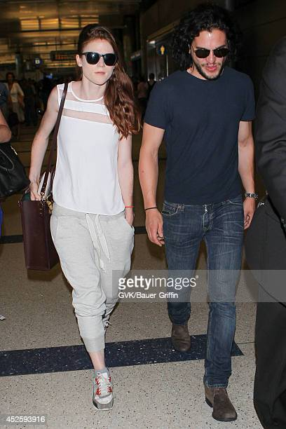 Kit Harington and Rose Leslie are seen at LAX on July 23 2014 in Los Angeles California
